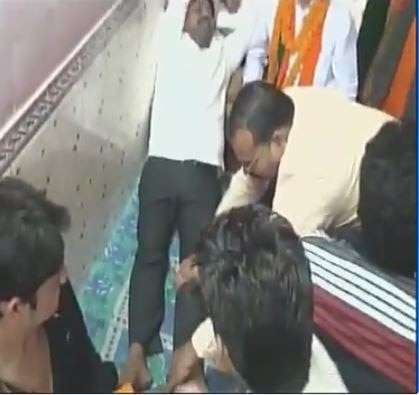 WATCH: WATCH: Yogi Adityanath's cabinet Minister Nand Gopal 'Nandi' gets foot massage by BJP workers after local body polls campaigning, in Allahabad