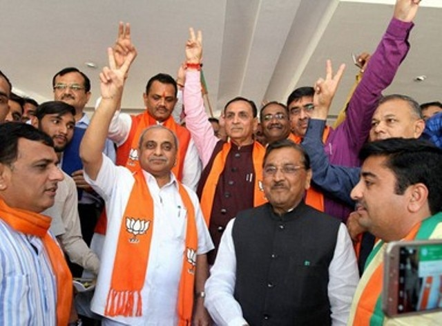 Parrikar congratulates Rupani for winning assembly seat