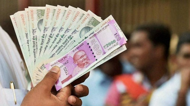 As domestic indices turn flat, rupee sinks to all-time low of Rs 74.27 against US dollar
