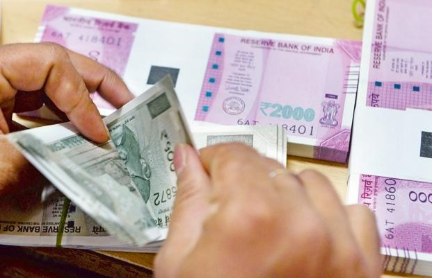 INR vs USD: Indian rupee trades 42 paise higher to 73.15 against US dollar