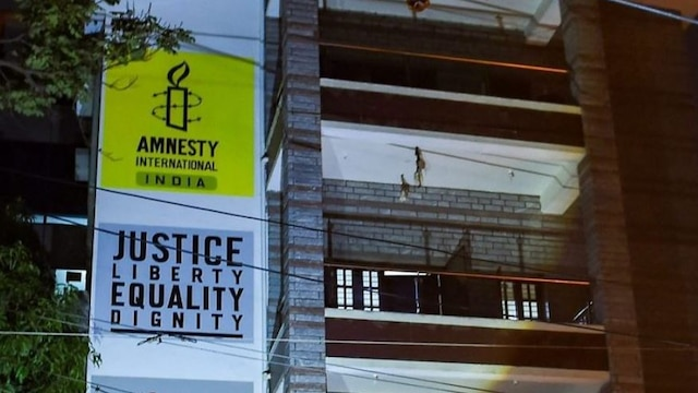 ED freezes bank accounts of Amnesty India; NGO commends raids, accuses govt of instilling fear