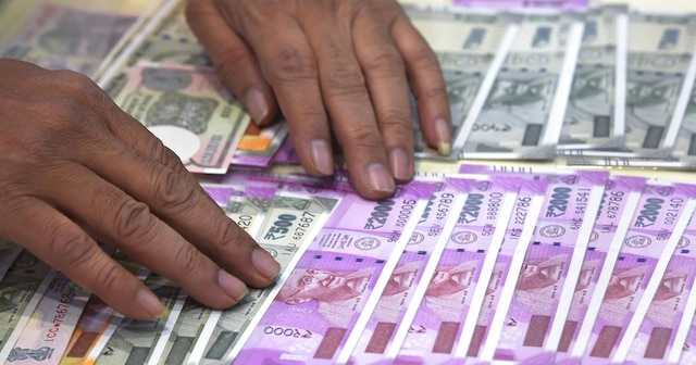 INR vs USD: Rupee posts massive gains; trades below 70 a dollar for first time since Aug 27