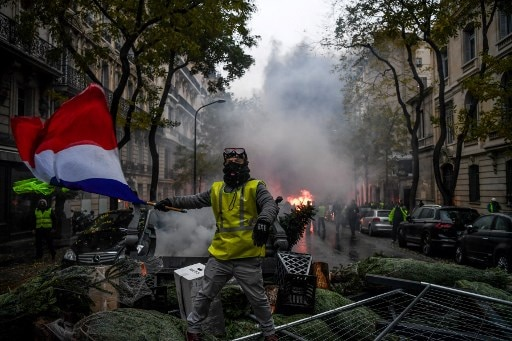 France Yellow Vest protests: Government suspends planned fuel price hike; all you need to know