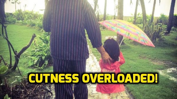 AWWDORABLE PIC: Akshay Kumar takes daughter Nitara out for a walk on a RAINY DAY!