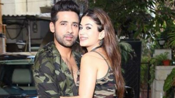 PIC ALERT! Bigg Boss 11 lovebirds Puneesh & Bandgi TWINNING in their military print outfits!