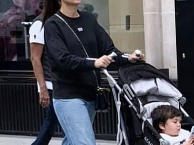 Kareena Kapoor Khan takes Taimur li Khan out for a stroll on London streets, Baby busy on his 'mobile'!