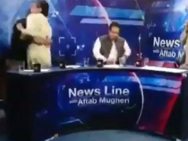 Watch: TV Debate In Pakistan Turns Into A Wrestling Match As PTI Leader, Journalist Get Violent