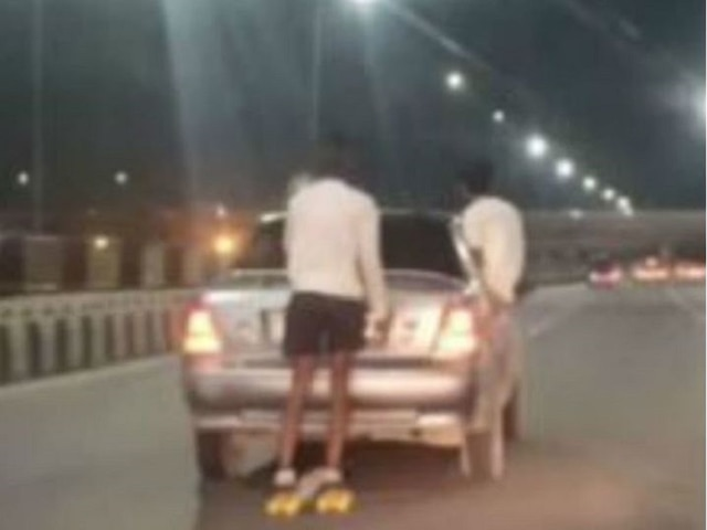 Traffic Police Fines Two Men After Video Of Their Stunts On Moving Car Surfaced On Social Media