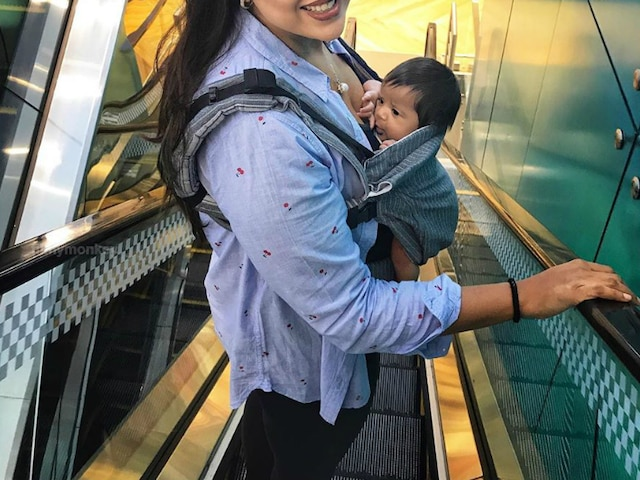 Sameera Reddy shared pic carrying newborn daughter Nyra Varde at a mall on International Babywearing Week!