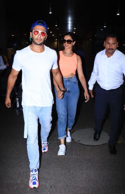 IN PICS: छुट्टियों से वापस लौटे रणवीर और दीपिका, एयरपोर्ट हाथों में हाथ डाले आए नजर