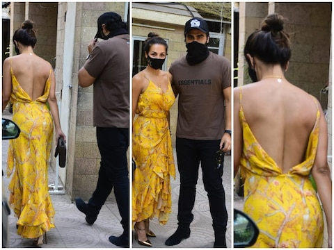 Malaika Arora arrives at the parents' house at Aster Lunch with Arjun Kapoor in a backless dress.
